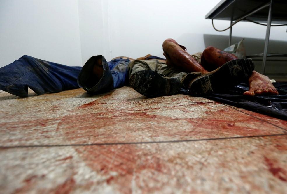 Corpos das vítimas do massacre em fazenda no Pará  (Foto: Lunae Parracho/Reuters )