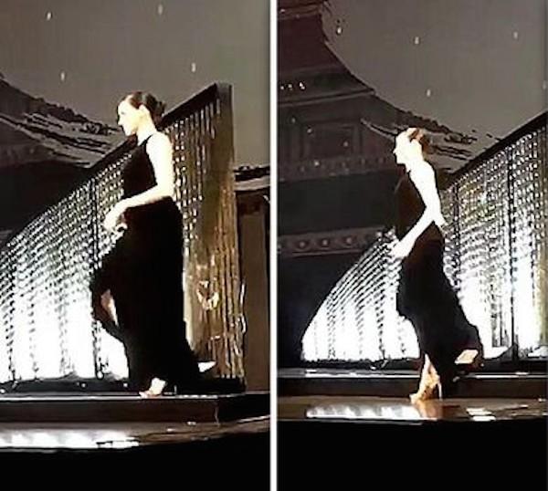 A atriz e duquesa Meghan Markle no instante em que pisa no próprio vestido e quase cai em evento realizado em Londres (Foto: Reprodução)