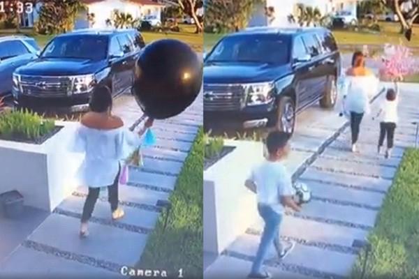 Criança estoura balão antes de chá-revelação (Foto: Reprodução/Youtube)