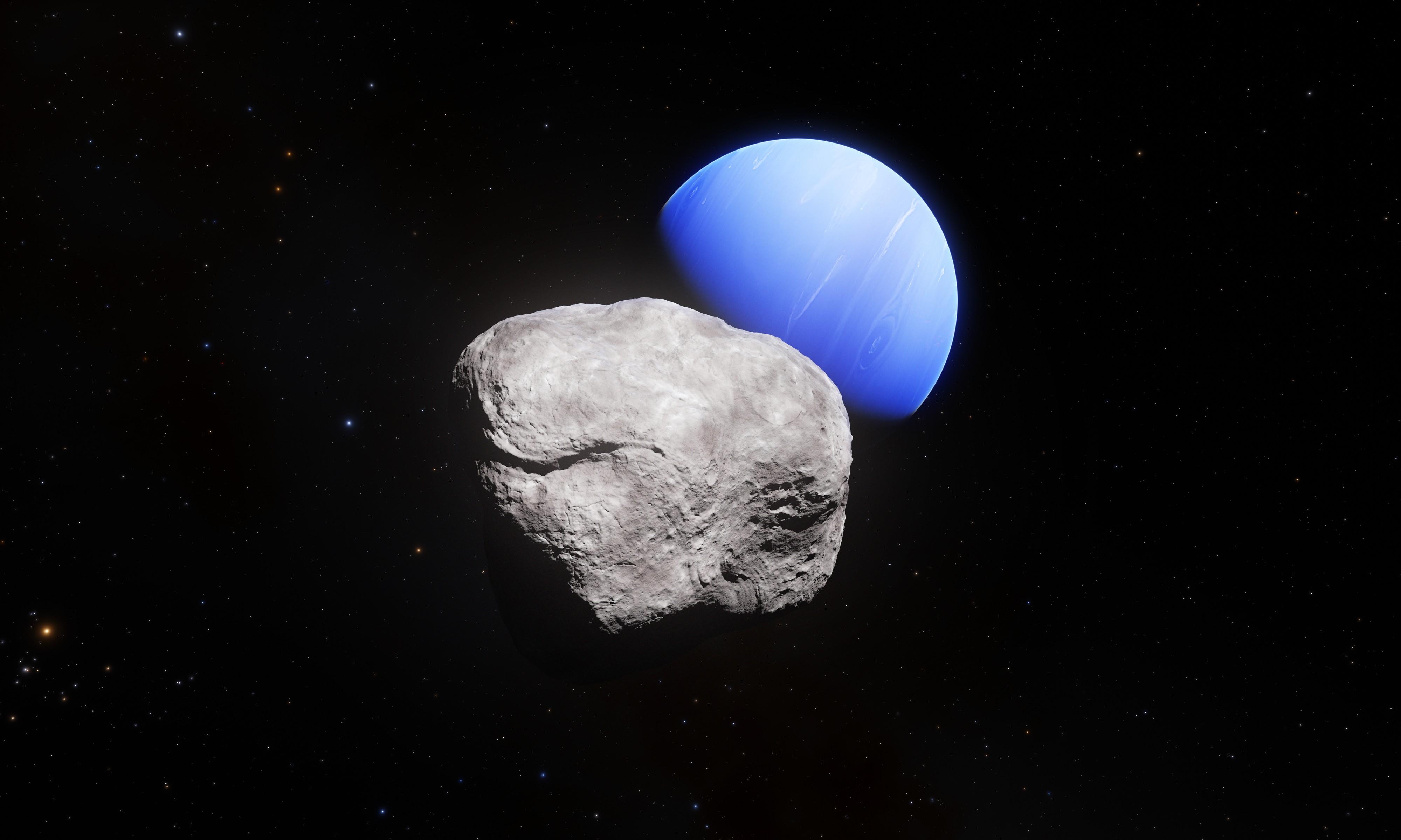 Montagem do planeta Netuno ao lado da lua Hippocamp (Foto: ESA/Hubble, NASA, L. Calçada)