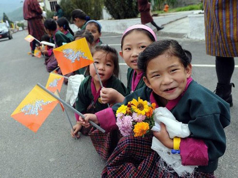 Crianças butanesas (Foto: Prakash Singh;AFP)