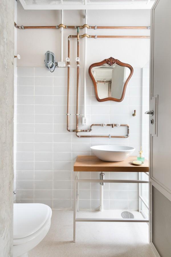 Décor do dia: lavabo de clima industrial com tubulações de cobre aparentes (Foto: Alexandre Disaro / Divulgação)