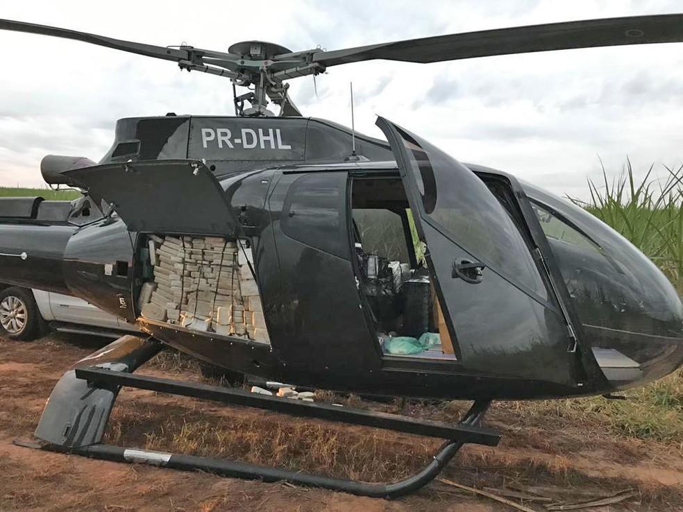 Helicóptero que transportava cocaína é apreendido em canavial em Presidente Prudente, interior paulista â?? Foto: Divulgação/PF-SP