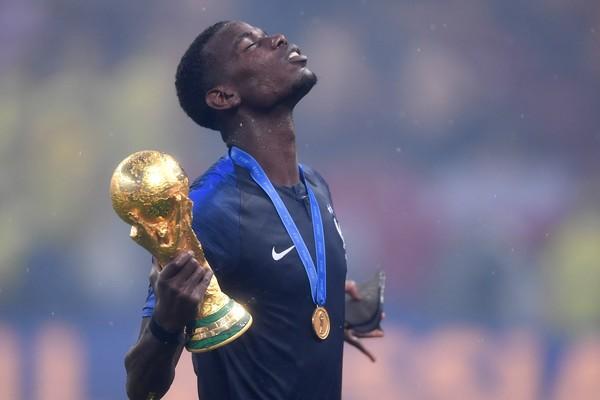 O craque francês Paul Pogba celebrando a vitória francesa na final da Copa do Mundo (Foto: Getty Images)