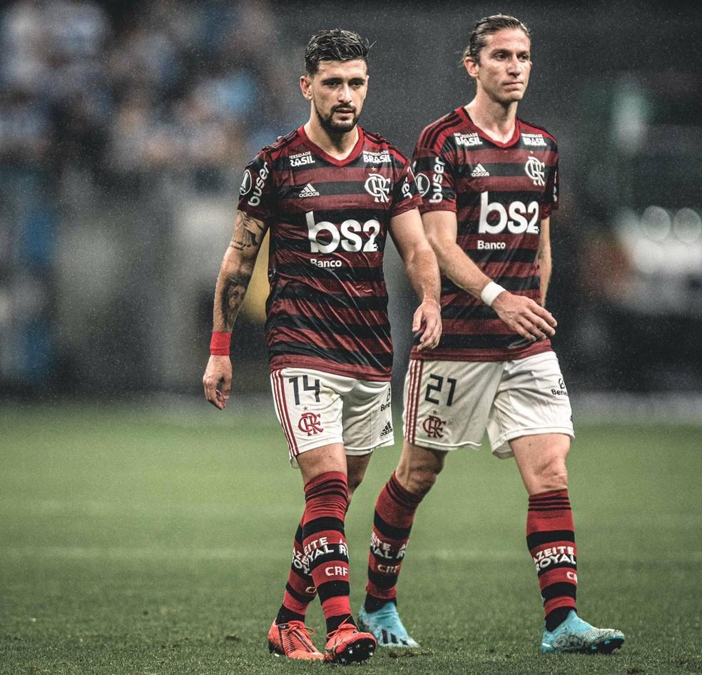 Arrascaeta e Filipe Luis serão desfalques no próximos jogos — Foto: Pedro Martins / Azeite Royal