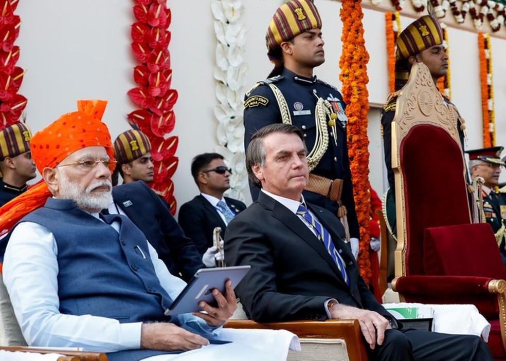 O presidente Jair Bolsonaro ao lado do primeiro-ministro Narendra Modi, durante cerimônia de comemoração do Dia da República da Índia — Foto: Alan Santos /PR