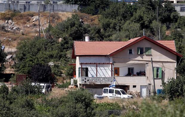 Ataque ocorreu na comunidade de Kiryat Arba (Foto: Mussa Qawasma/Reuters)
