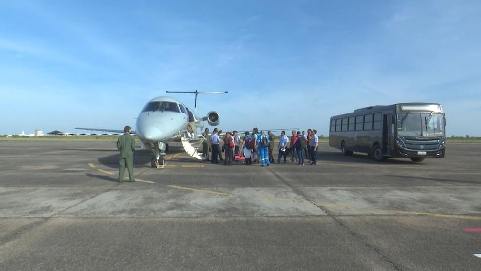 Imigrantes venezuelanos embarcam no C99 da Força Aérea Brasileira, em Boa Vista — Foto: Rede Amazônica Roraima/Reprodução