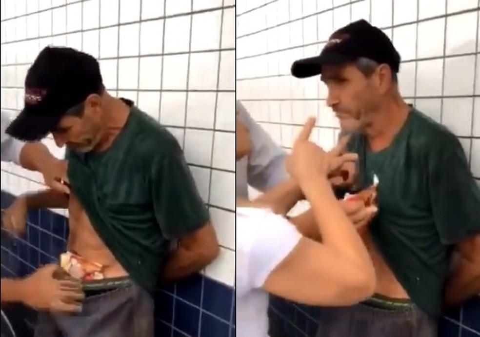 Vídeo mostra Vanderlei Rafael da Silva sendo agredido após ser flagrado com comida escondida dentro da calça, em Matinhos — Foto: Reprodução/Twitter