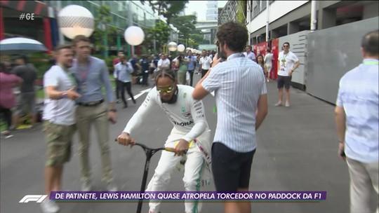 De patinete, Lewis Hamilton quase atropela torcedor no Paddock da F1
