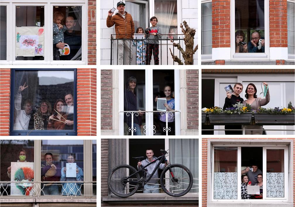 19 de março - Moradores de Bruxelas, na Bélgica, posam de suas varandas com objetos de estima durante quarentena imposta devido ao coronavírus — Foto: Yves Herman/Reuters