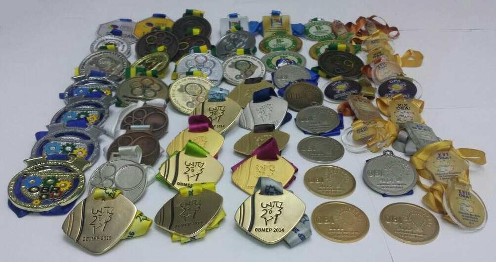 Gêmeos Gabriel e Matheus Nunes, de 18 anos, acumularam mais de 60 medalhas em olimpíadas do conhecimento no ensino fundamental e no médio (Foto: Arquivo pessoal/Gabriel e Matheus Nunes)