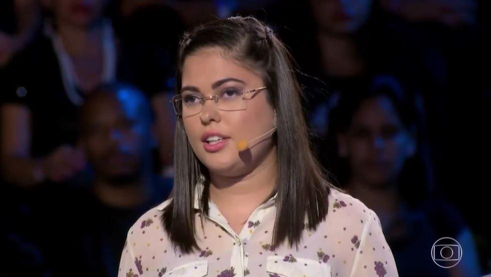 Ekarinny contou sua história no palco do 'Caldeirão' — Foto: Globo