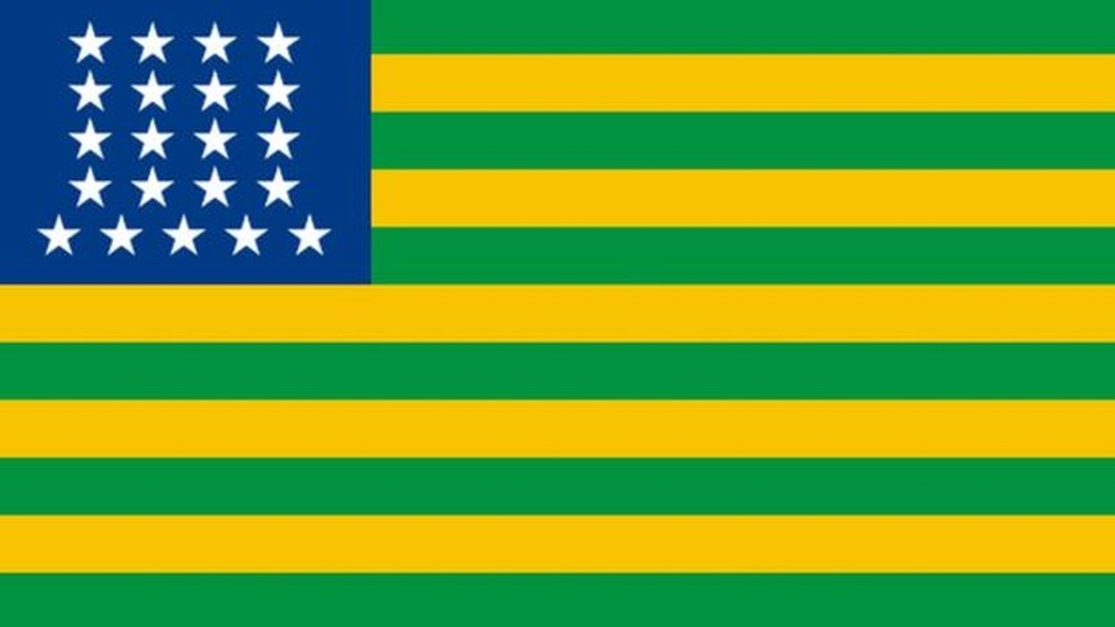 Primeira bandeira republicana do Brasil, com faixas em verde e amarelo, e estrelas — Foto: Reprodução/via BBC