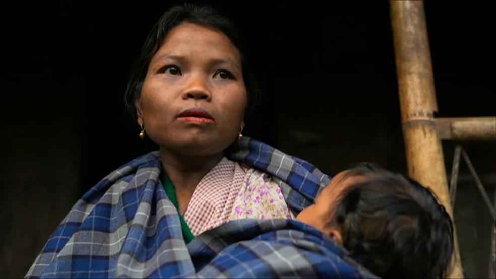 Mulher no vilarejo Kong Thong — Foto: BBC News