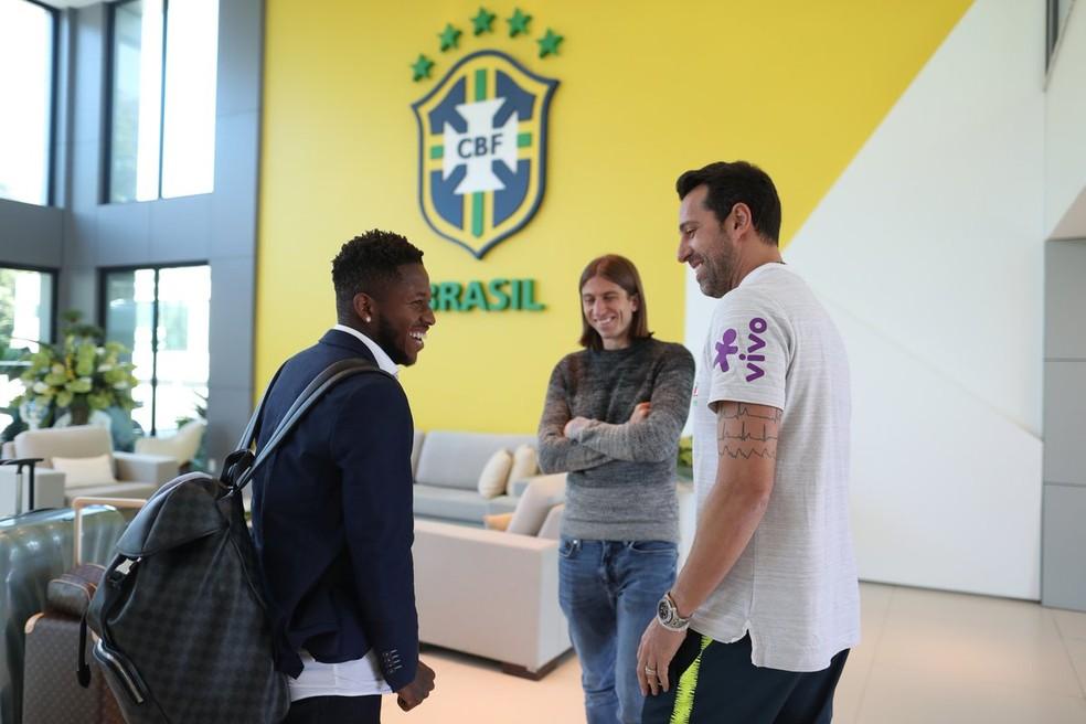 Edu recebe Fred e Filipe Luís em Teresópolis (Foto:  Lucas Figueiredo/CBF)