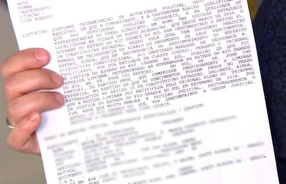 Boletim de ocorrência registrado por funcionário público que teve salário parcelado (Foto: Reprodução/RBS TV)