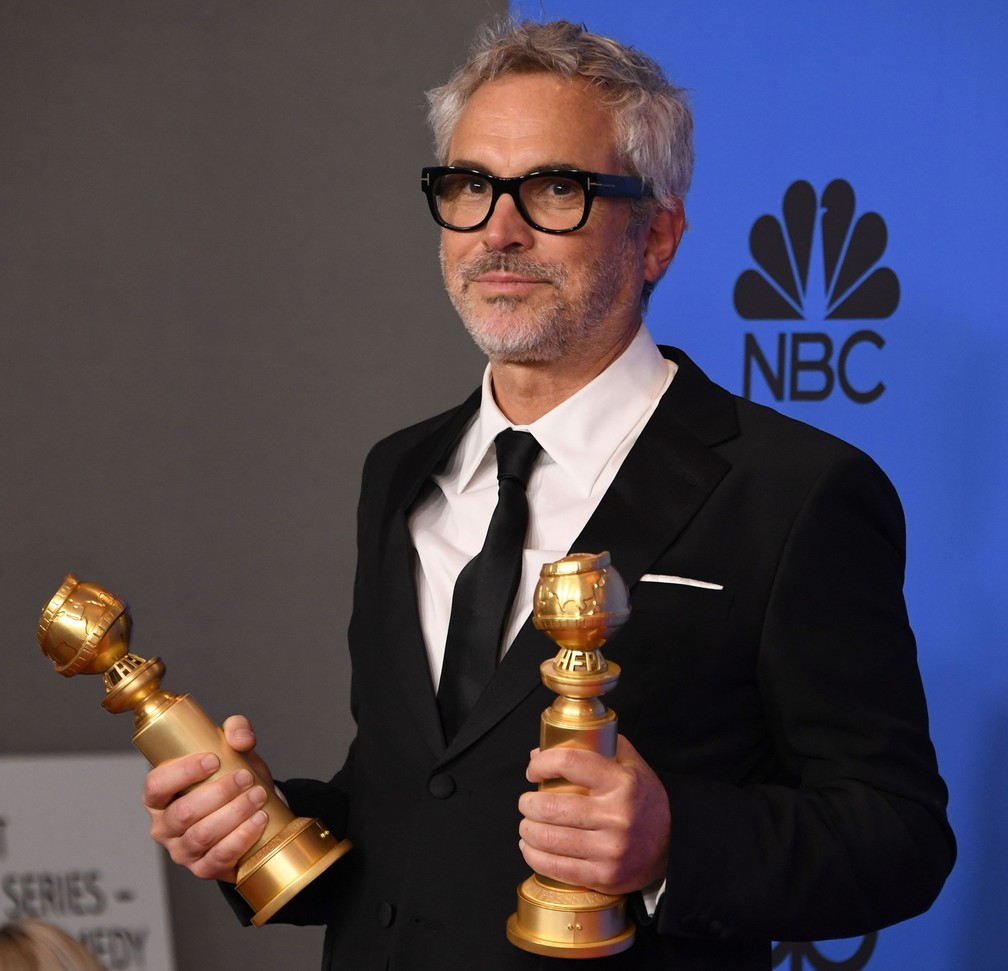 Alfonso Cuarón ganha dois Globos de Ouro por 'Roma': melhor diretor e melhor filme estrangeiro — Foto: Mark Ralston/AFP