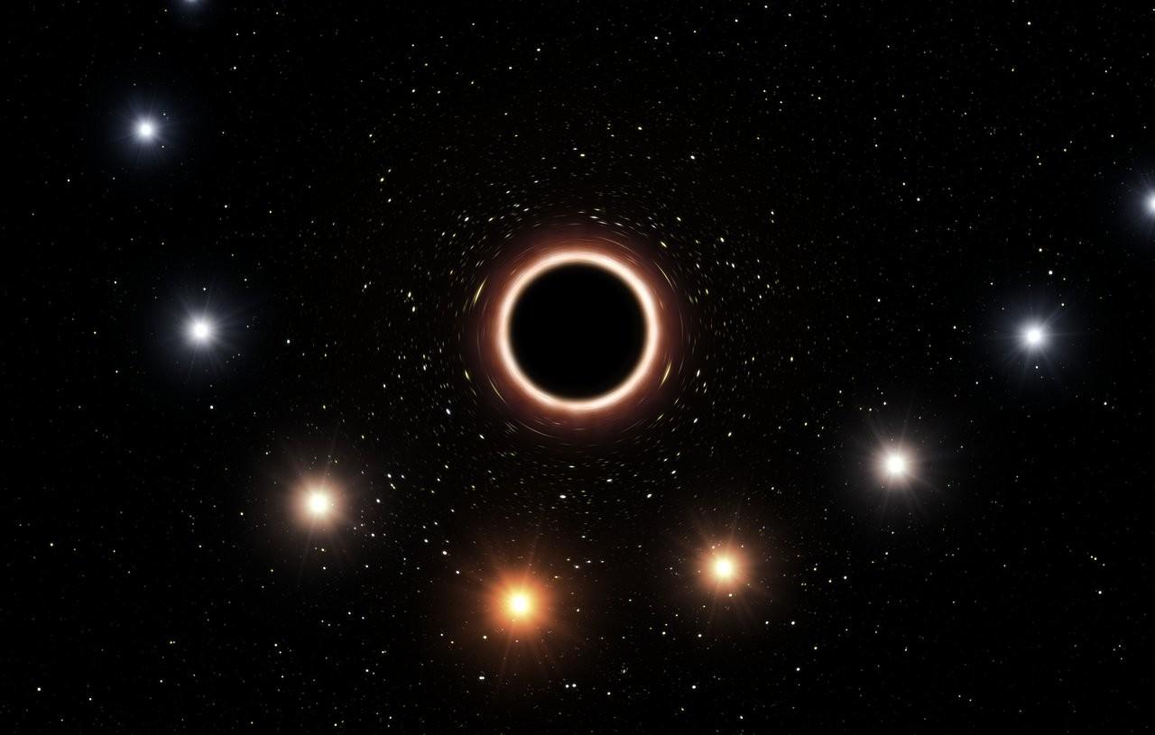 Simulação exibe estrela S2 passando próxima a buraco negro (Foto: Divulgação/ESO)