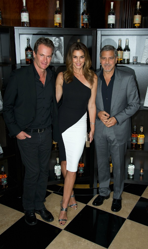 Cindy Crawford, George Clooney e o marido da modelo (Foto: Getty Images)