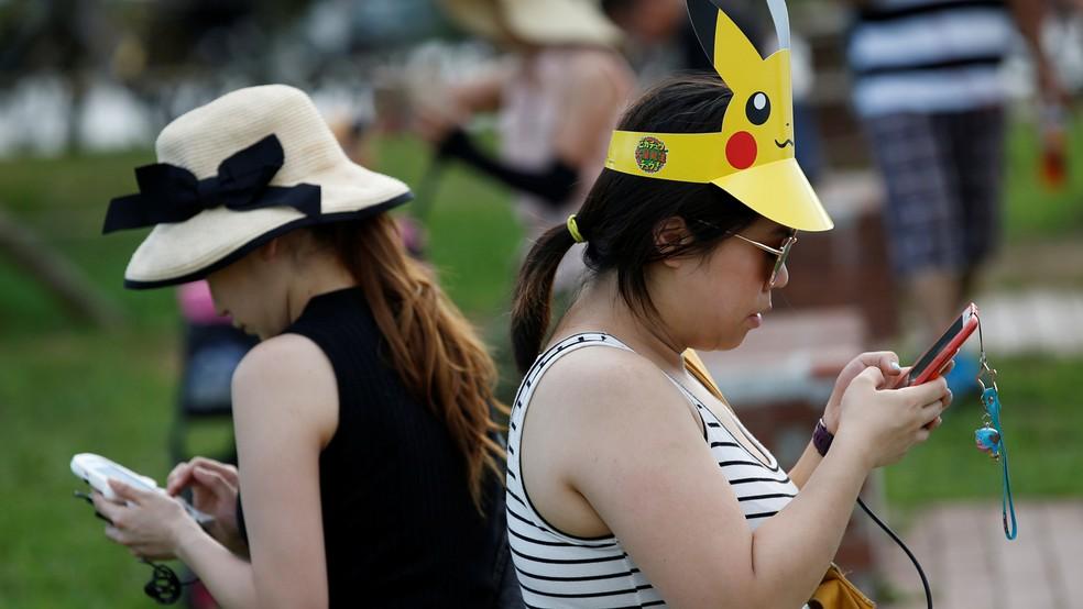 Jogadores de 'Pokémon Go' aproveitaram evento do game em Yokohama, no Japão, para capturar mais monstrinhos (Foto: REUTERS/Kim Kyung-Hoon)