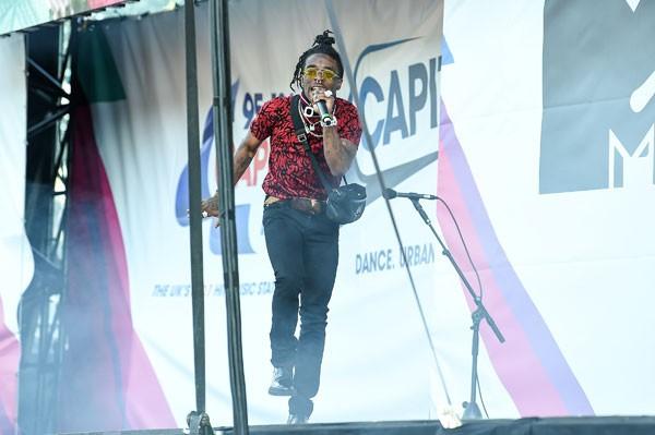 No mês passado, rapper disse aos fãs no Festival Wireless em Londres, na Inglaterra, que eles estavam indo para o inferno com ele (Foto: Tabatha Fireman/Getty Images)