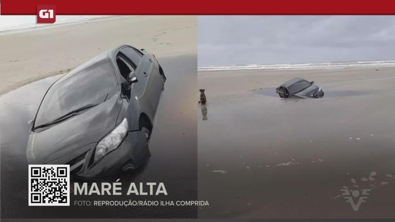 G1 em 1 Minuto - Santos: Maré avança e inunda carro de turistas atolado na faixa de areia