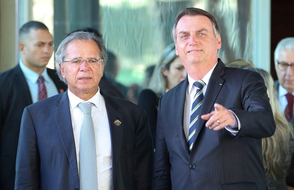 O presidente Jair Bolsonaro e o ministro da Economia, Paulo Guedes — Foto: Fabio Rodrigues Pozzebom/Agência Brasil