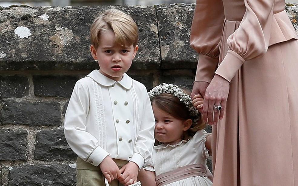 Irmã de Kate, Pippa Middleton se casa na Inglaterra, e príncipes George e Charlotte, em imagem de arquivo (Foto: Kirsty Wigglesworth/Reuters)