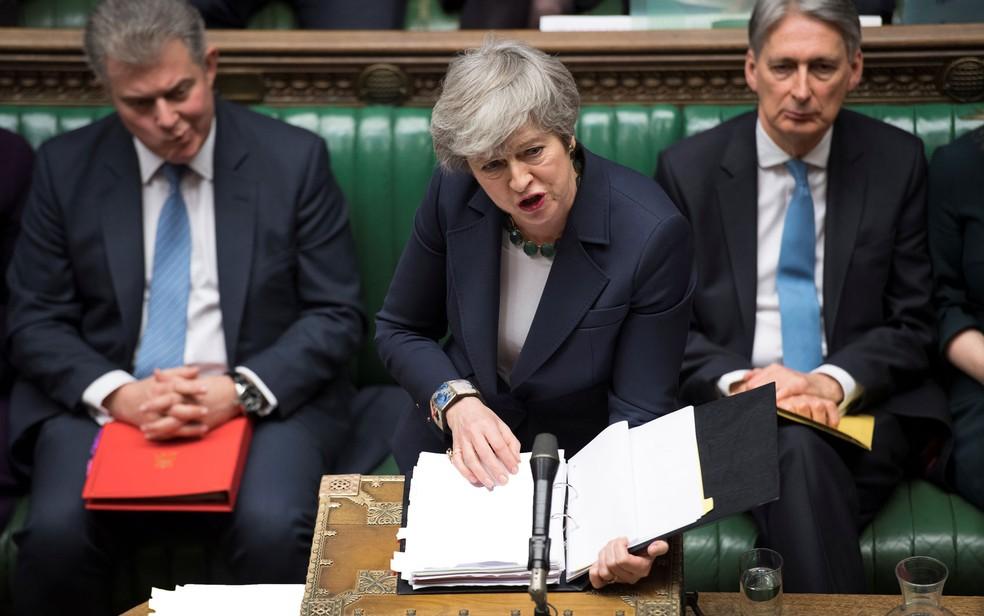 A primeira-ministra britânica Theresa May fala ao Parlamento antes da votação sobre a possibilidade de um Brexit sem acordo, na quarta-feira (13) — Foto:  UK Parliament/Jessica Taylor/Handout via Reuters