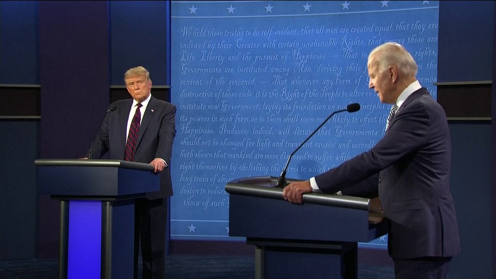 Donald Trump e Joe Biden em primeiro debate nos Estados Unidos — Foto: Reprodução/GloboNews