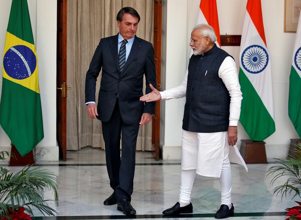 O presidente brasileiro Jair Bolsonaro e o premiê Narendra Modi em Nova Déli, neste sábado (25) — Foto: Reuters/Altaf Hussain