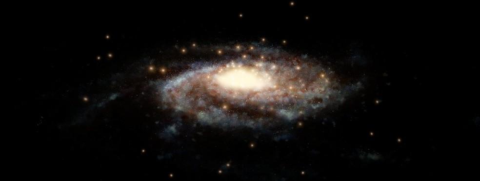 Impressão artística da Via Láctea e seus aglomerados globulares — Foto: Nasa / ESA / Hubble
