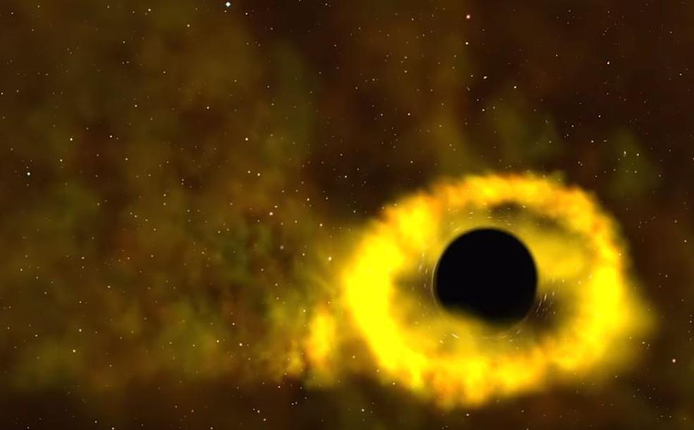 """Ilustração da Nasa mostra o momento em que estrela é """"devorada"""" por buraco negro. O aro iluminado é composto por gases — Foto: Reprodução/Nasa"""