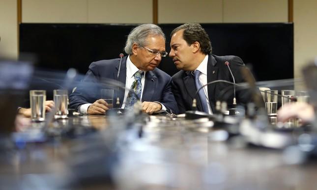 Guedes e o presidente da Caixa, Pedro Guimarães