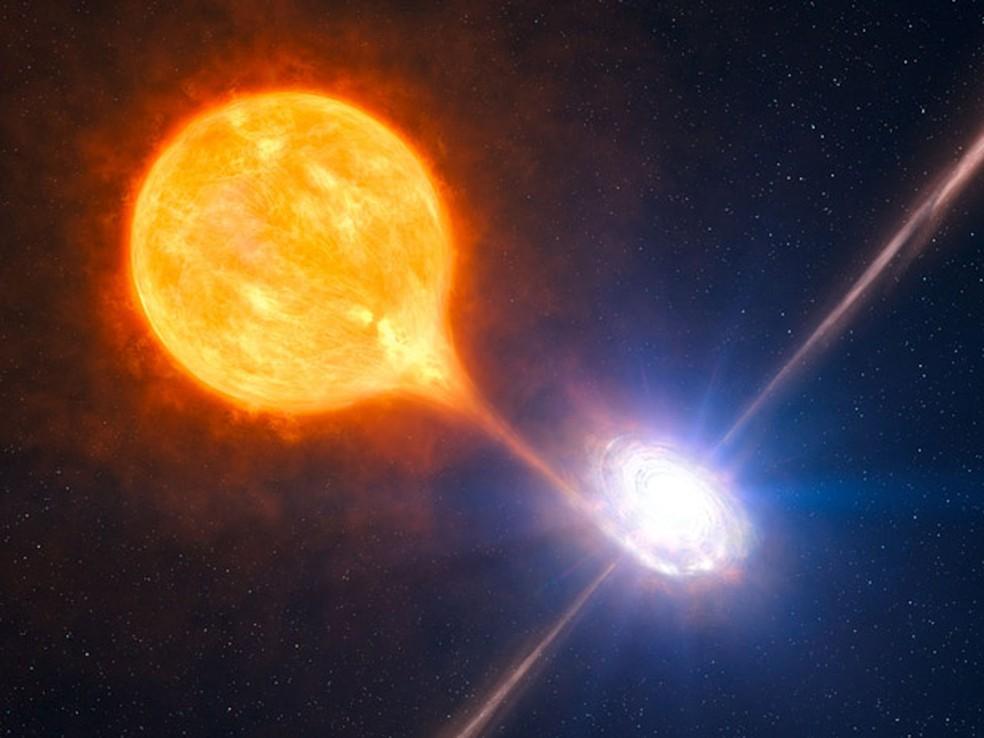 Reprodução artística do sistema binário observado na NGC 7793, no qual o buraco negro está inserido. — Foto: ESO/L. Calçada