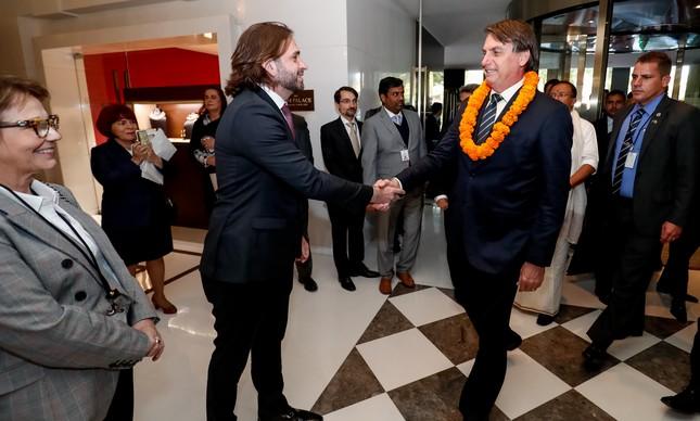 O ex-secretário-executivo da Casa Civil Vicente Santini e o presidente Jair Bolsonaro