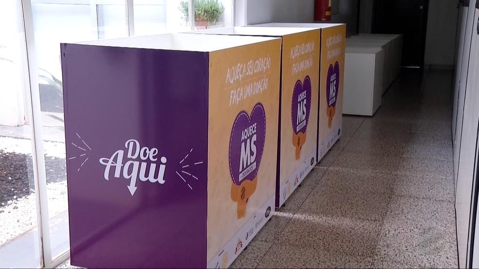 Caixas de arrecadação da campanh Aquece MS 2018 Dourados (Foto: Reprodução/TV Morena)