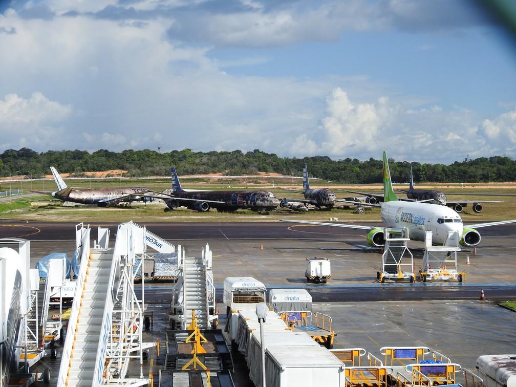 Aeronaves foram deixadas no local após a falência de empresas, após as aeronaves terem o certificado de aeronavegabilidade cancelado ou terem sido acidentadas. — Foto: Patrick Marques/G1 AM