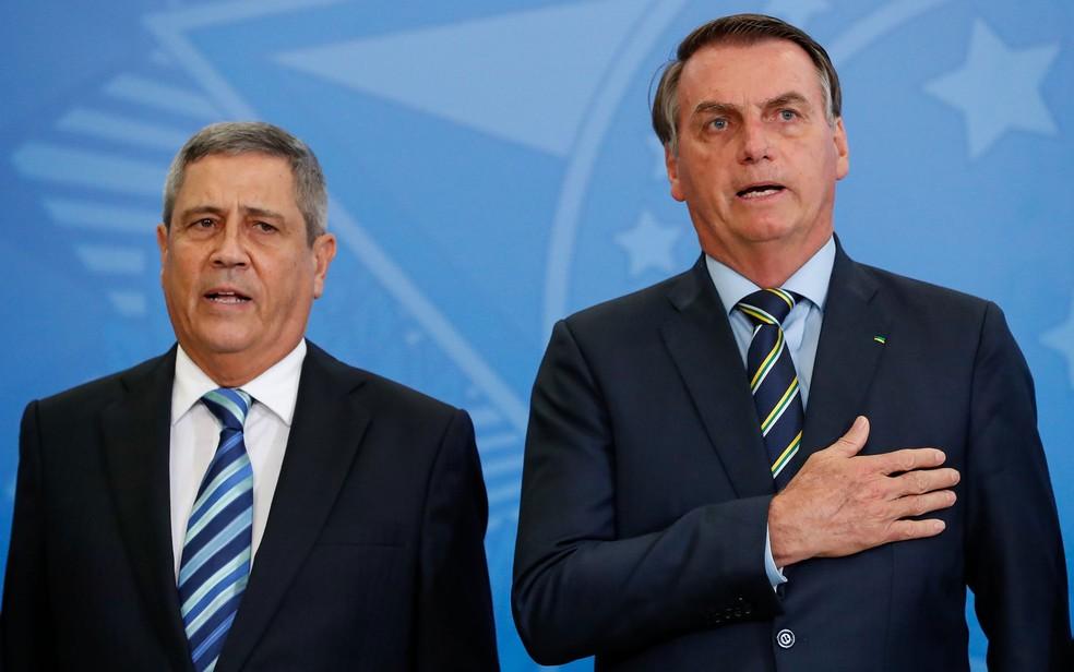 Walter Braga Netto, novo ministro da Defesa, ao lado do presidente Jair Bolsonaro — Foto: Alan Santos/PR