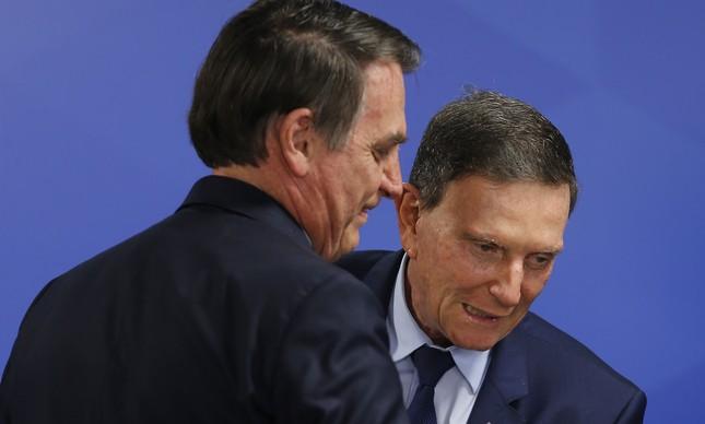 Bolsonaro e Crivella na posse do presidente do BNDES, Gustavo Montezano