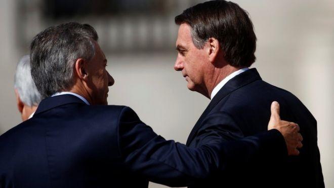 Em visita à Argentina, Bolsonaro defendeu a criação de uma moeda única para o Brasil e o país comandado por Macri (Foto: JUAN MABROMATA - AFP / Via BBC News Brasil)