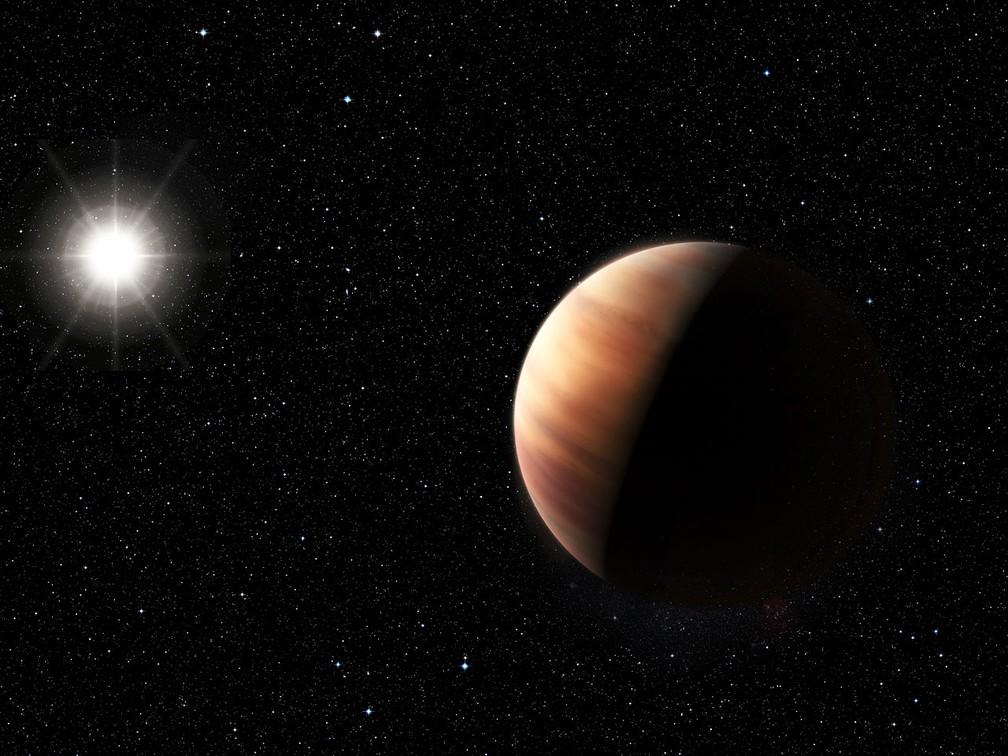 Concepção artística do recentemente descoberto planeta gigante gasoso gêmeo de Júpiter em órbita de uma estrela gêmea do Sol, HIP 11915 — Foto: ESO/M. Kornmesser