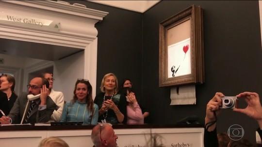 Obra de Banksy se autodestrói após ser leiloada por 1 milhão de libras