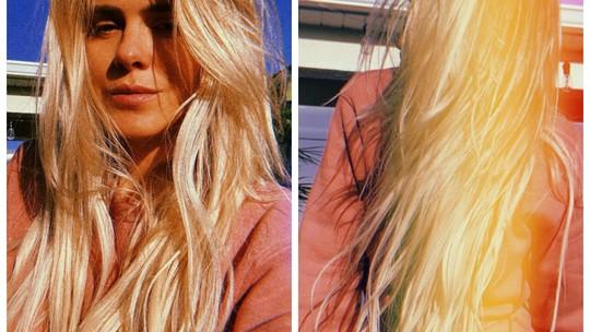 Carolina Dieckmann alonga os cabelos e ganha elogio de Camila Pitanga: 'Gata'