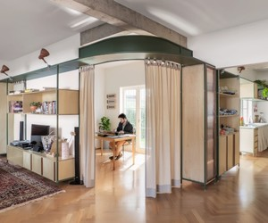 Com jardim e planta em L, apê de 125 m² parece uma casa
