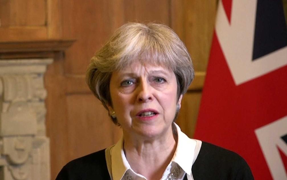 Primeira-ministra britânica Theresa May fala em Londres (Foto: Reino Unido / via AP Photo)