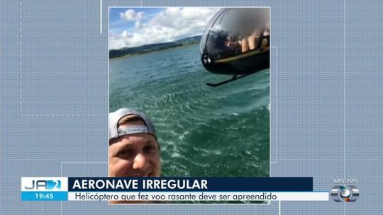 Helicóptero flagrado por sertanejo a poucos metros de lancha é proibido de voar, diz Anac