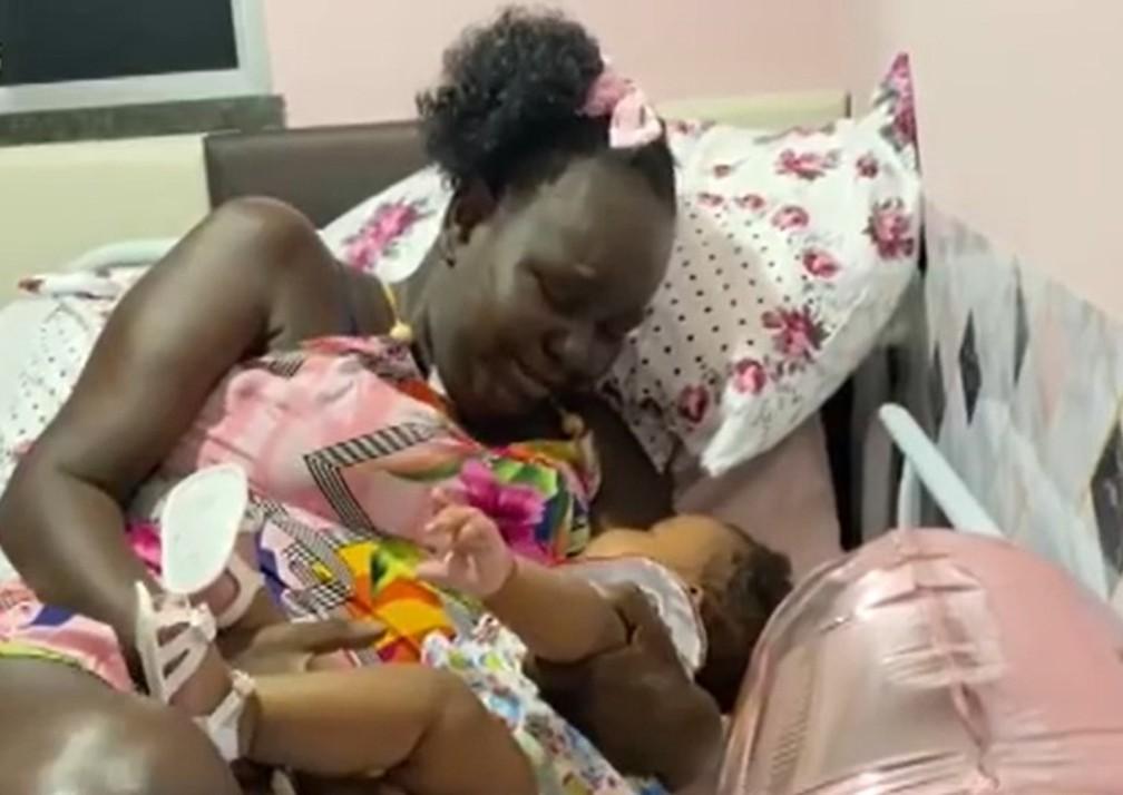 Mulher conhece filha após ter duas paradas cardíacas e ficar quase cinco meses internada com Covid-19 em Salvador — Foto: Reprodução / TV Bahia
