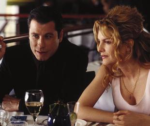 John Travolta e Rene Russo em 'O nome do jogo' | Divulgação